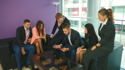 business man shows a group  something on the Tablet