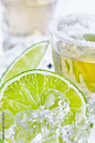 gold tequila with salt and lime © Igor Normann