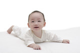 Cute baby lying on white bedcover
