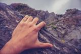 Man's hand on rock