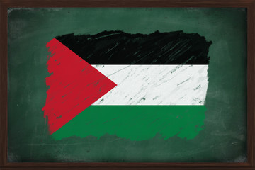 Palestine flag painted with chalk on blackboard