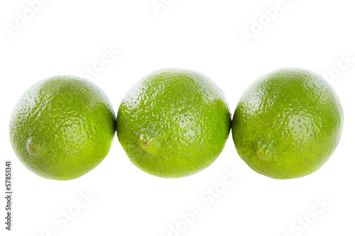 Three limes on the isolated white background