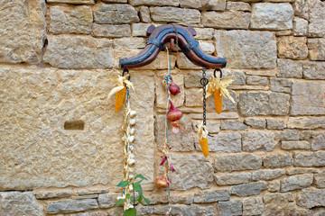 Traditional Dalmatian ornament on stone wall
