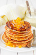 A Stack of Pumpkin Pancakes Topped with Pumpkin Preserves