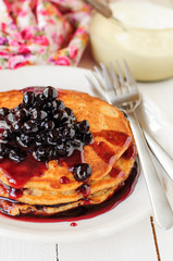 A Stack of Pumpkin Pancakes Topped with Chokeberry Preserves