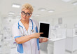 Funny mature doctor with tablet PC at lab