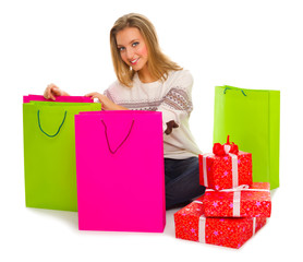 Young girl with bags and gift boxes