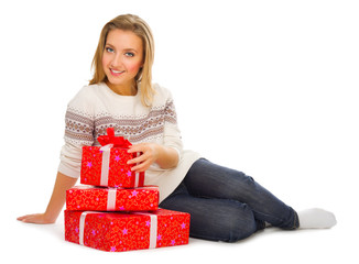 Young smiling girl with gift boxes