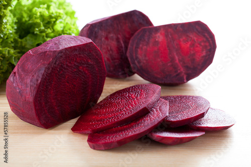 Purple beetroot on wooden board
