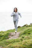 Pretty sportswoman jogging
