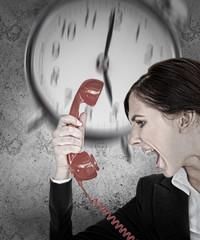 Businesswoman under pressure with deadline