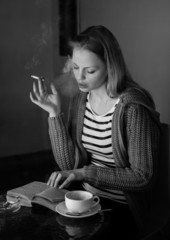 Attractive woman smoking cigarette