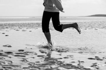 Sportswoman running on the beach