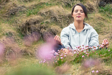 Attractive woman meditating