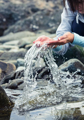 Woman splashing water of the river