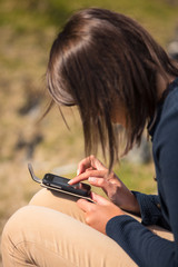Brunette using a smartphone