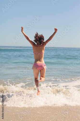 Happy woman raising arms