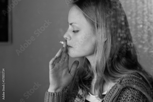 Beautiful woman smoking cigarette