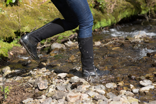 Woman jumping into river