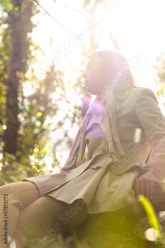 Woman sitting in front of the sun