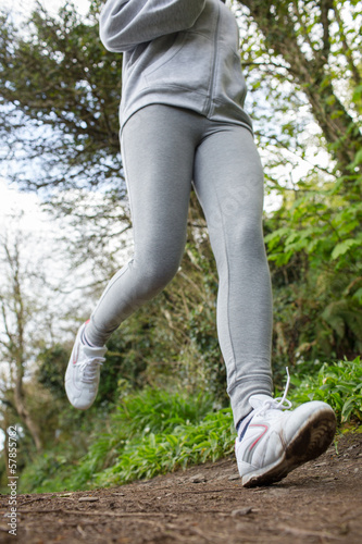 Sportswoman running in the forest