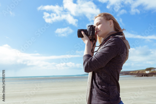 Attractive woman taking pictures