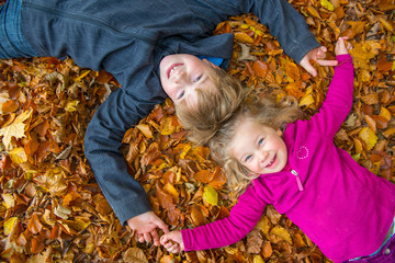 boy and girl in autumn foliage