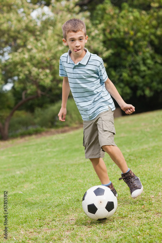 Son posing while playing football