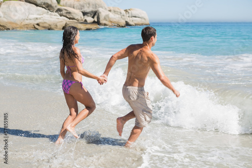 Young couple going bathing in the sea