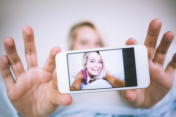 Picture on smartphone of gorgeous cheerful blonde