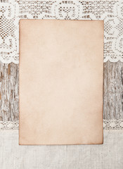 Aged paper and linen fabric on the old wood