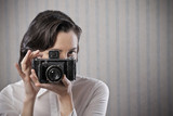 Woman with a old camera