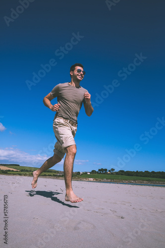 Attractive content man running