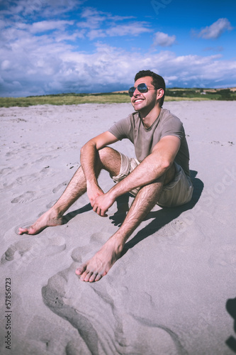 Attractive content man sitting and enjoying the sun