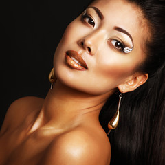 Young fresh luxury woman with golden makeup, beauty female portr