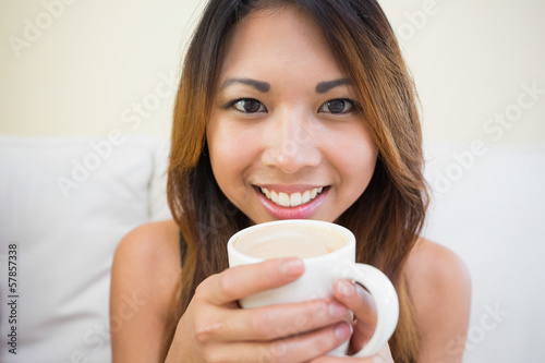 Pretty girl holding a cup