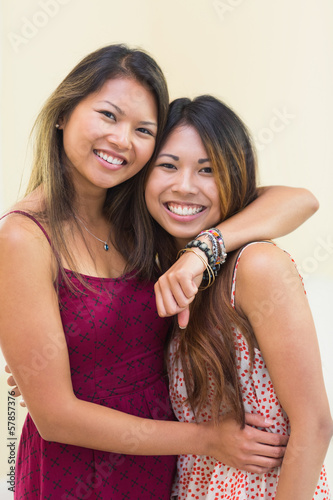 Two smiling women posing for the camera