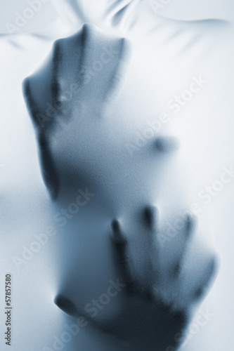 abstract hands, human arm inside fabric, toned blue