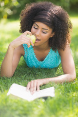 Gorgeous content brunette reading book eating apple
