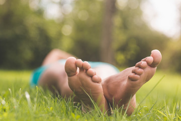 Picture of female feet lying on grass