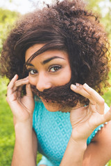 Gorgeous happy brunette pretending she has a mustache