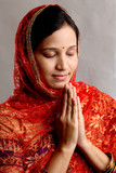 Indian woman holding hands in prayer position