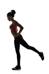 sport young athletic woman doing legs exercise, active fitness g