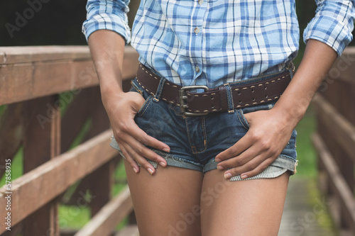 Close up of attractive model walking over bridge