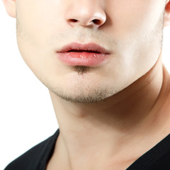 male lips, chin and cheekbone coseup, face detail of young man