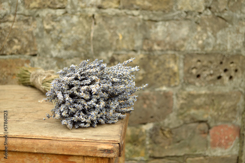 bouquet of lavender lying on a brick wall