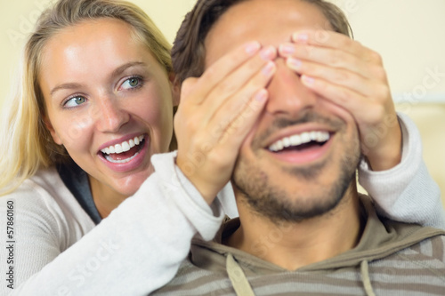 Laughing young woman having fun with her boyfriend