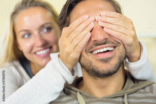 Amused young woman making fun with her boyfriend