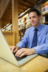 Content librarian working at laptop