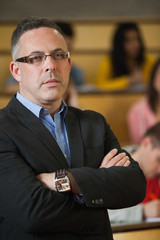 Lecturer frowning at camera in front of class